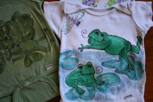 Frogs on blue with dragon fly